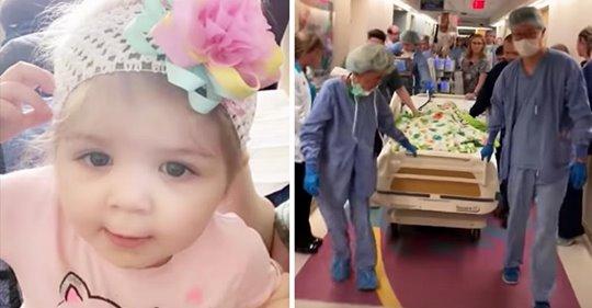 Die Belegschaft des Krankenhauses singt mit der Familie Amazing Grace, als die Einjährige zur Organspende gebracht wird