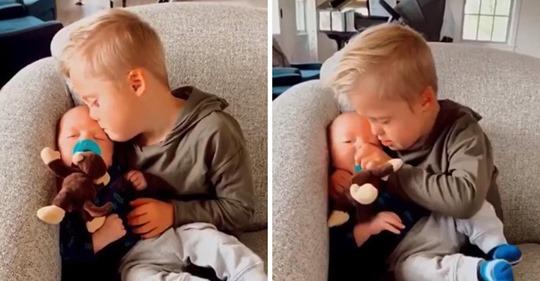 Eine Mama kann das Kind nicht dazu bringen, mit dem Weinen aufzuhören, aber dann übernimmt ihr Sohn mit Down Syndrom