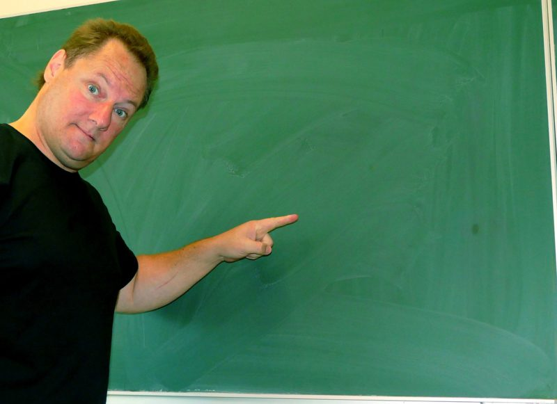 Interrassischer Lehrer Und Schüler